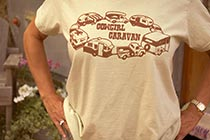 Woman's shirt: 'Cowgirl Caravan' with a circling of camping trailers